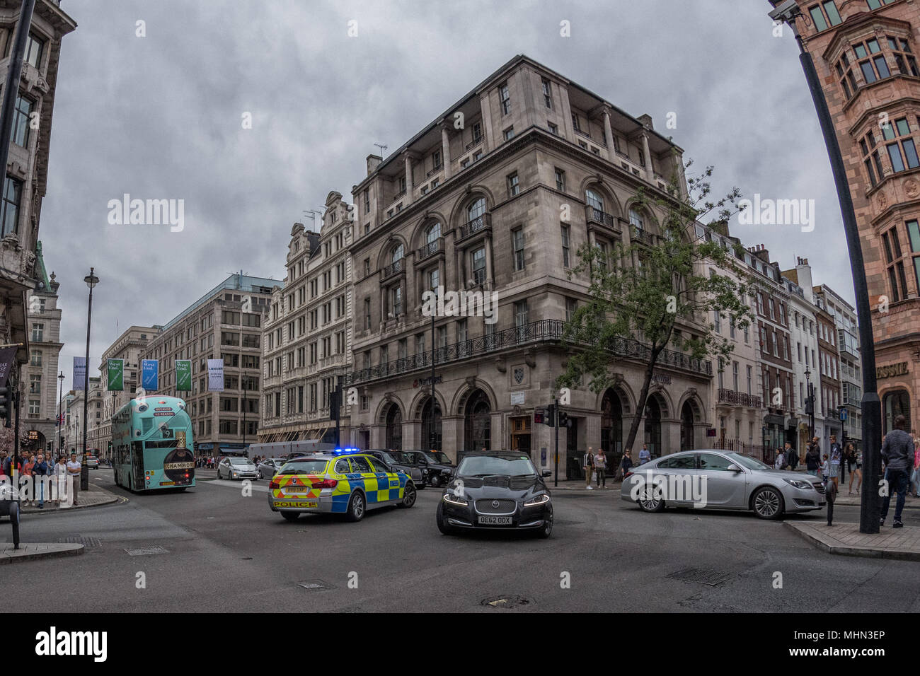 LONDON, ENGLAND - JULY 16 2017 - Tourists and locals in Piccadilly Circus congested town traffic of UK Capital - Stock Image