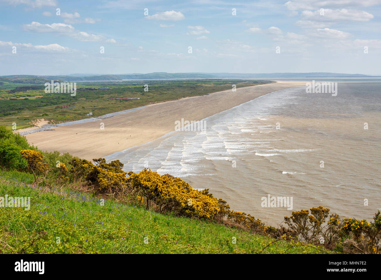 7 Mile stretch of flat beach at Pendine Sands in Carmarthenshire, Wales in the United Kingdom. - Stock Image