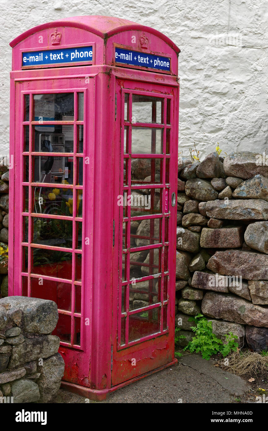 Old fashioned red telephone box offering e-mail text and phone services - Stock Image