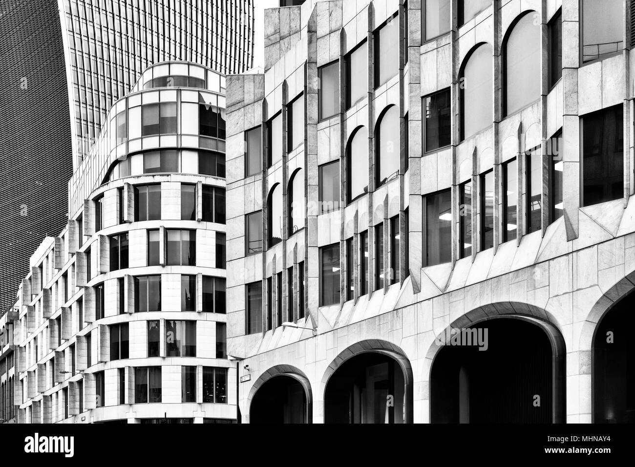 Old and new buildings abstract. Great Tower Street, London, England. Black and white - Stock Image