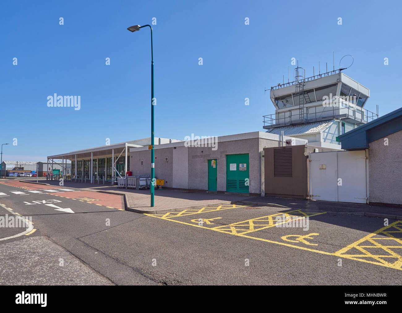 The Control Tower and Terminal Building at Dundee Airport, on the Tay Estuary on one fine Spring day in  Angus, Scotland. Stock Photo