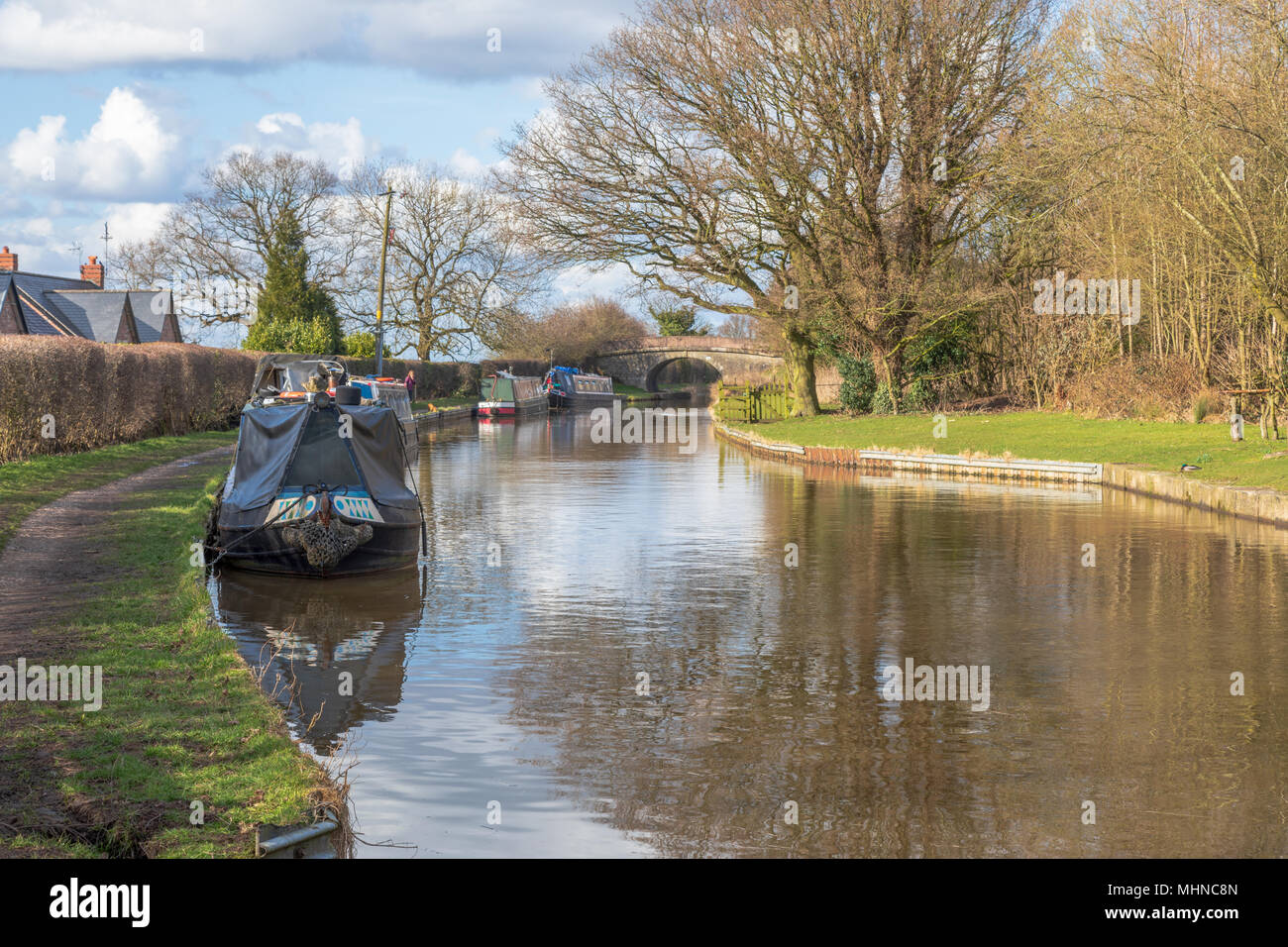 Narrow boats moored on the Macclesfield Canal near Bollington in  Cheshire.  The canal is a popular waterway used by visitors to Cheshire - Stock Image