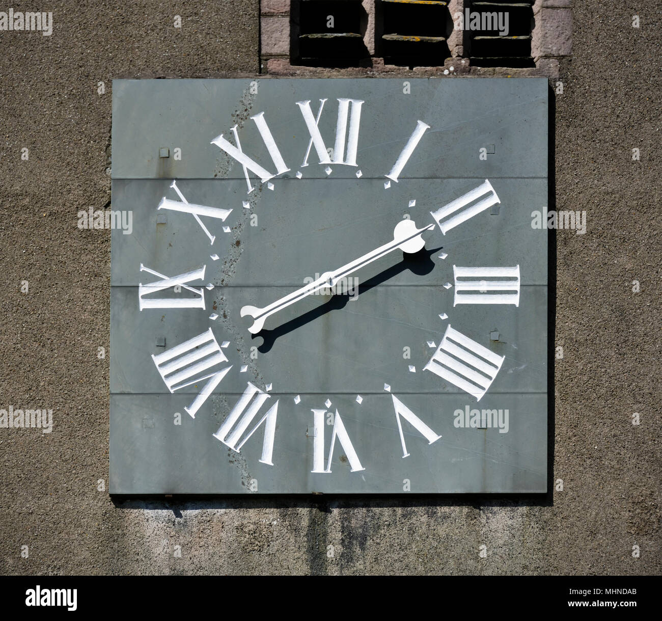 One-handed clock with Roman numerals. Parish Church of Saint Kentigern, Great Crosthwaite, Lake District National Park, Cumbria, England. - Stock Image