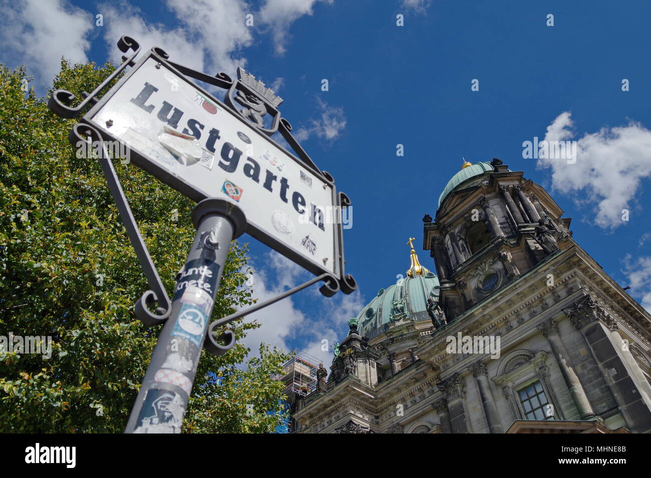 A view to Berliner Dome from bellow, with schedule Lustgarten - Stock Image