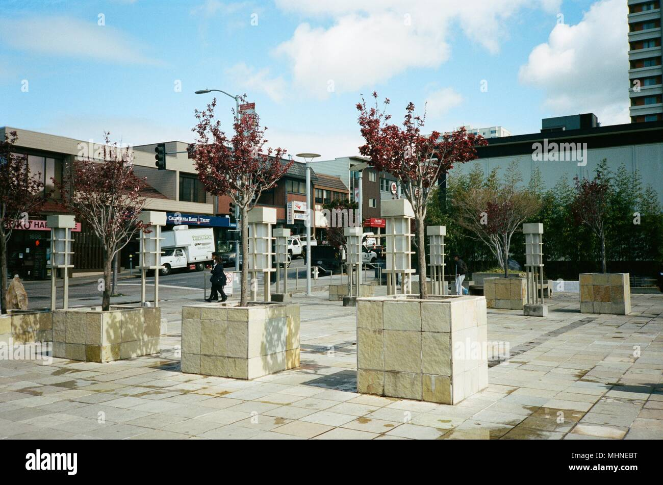 Young trees growing in planters at the Peace Plaza, a public park in Japantown, San Francisco, California, March 14, 2018. () - Stock Image