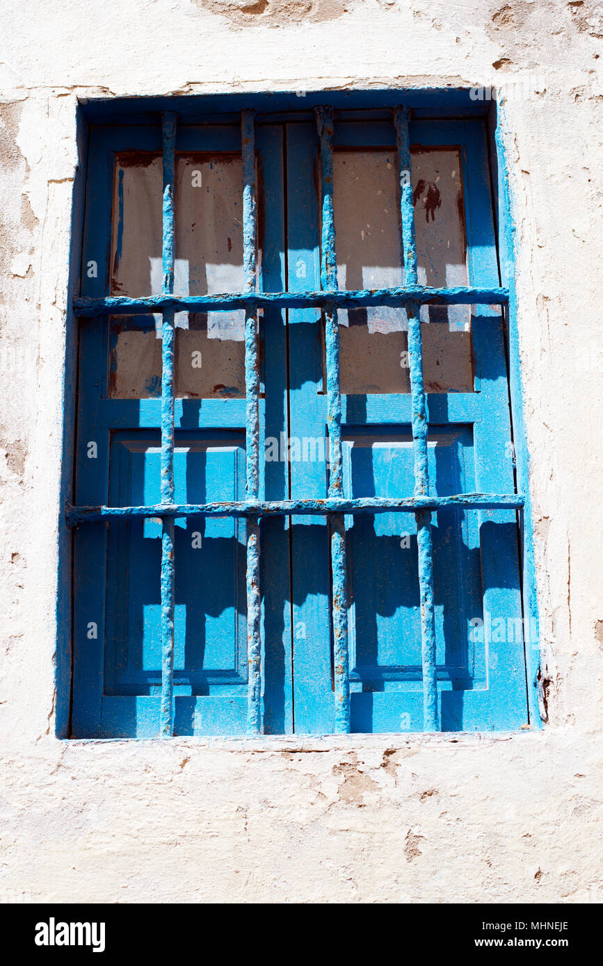 Blue window and shutters with security bars,Essaouira, Morocco, Africa. Stock Photo