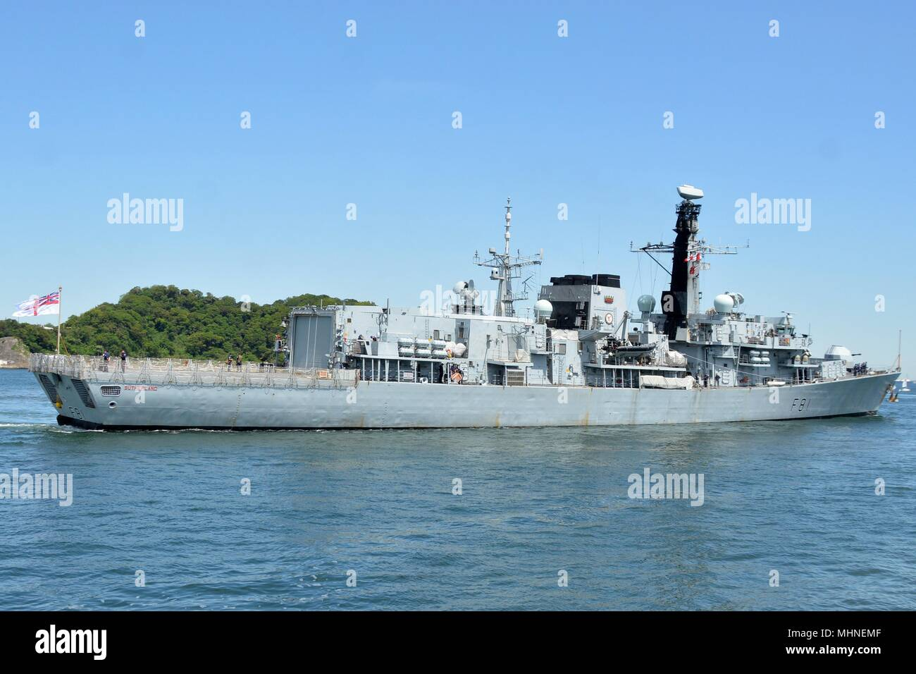 180411-N-XN177-0104 YOKOSUKA, Japan - The British Royal Navy Type 23 frigate HMS Sutherland (F 81) departs U.S. Fleet Activities (FLEACT) Yokosuka after a scheduled port visit, April 26, 2018. FLEACT Yokosuka provides, maintains, and operates base facilities and services in support of 7th Fleet's forward-deployed naval forces, 71 tenant commands, and 27, 000 military and civilian personnel. (U.S. Navy photo by Mass Communication Specialist 1st Class Peter Burghart/Released). () - Stock Image