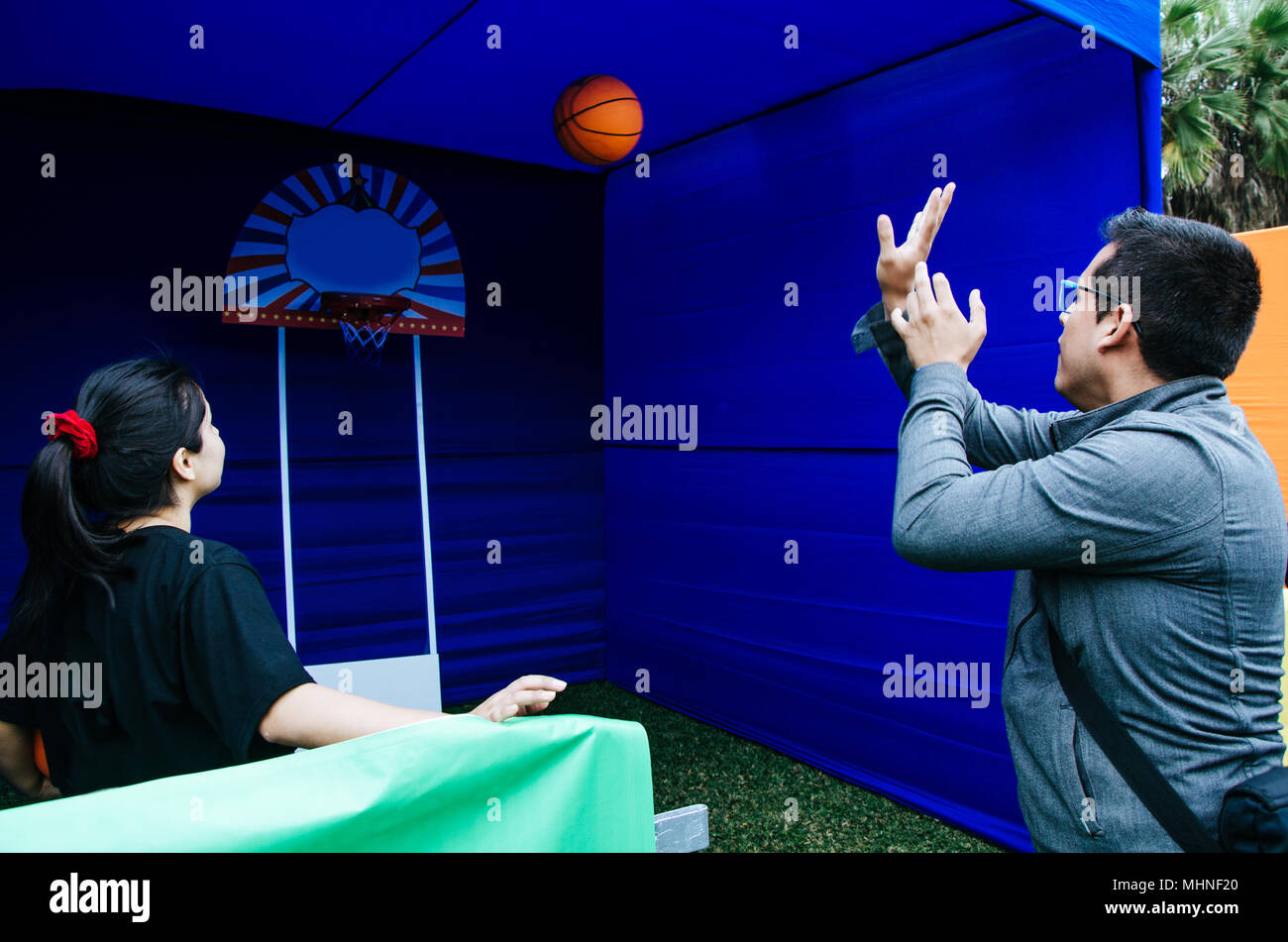 Lima, Peru - AUGUST 18th 2017: Entel Festival . Game of dunk the ball, in the festival - Stock Image