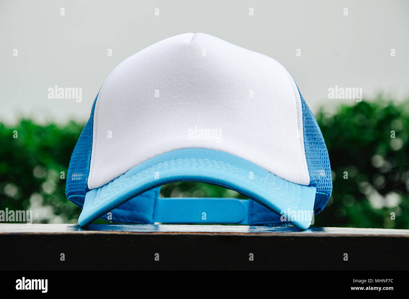 e7c46c1e657 White trucker cap with light blue without logo - Stock Image