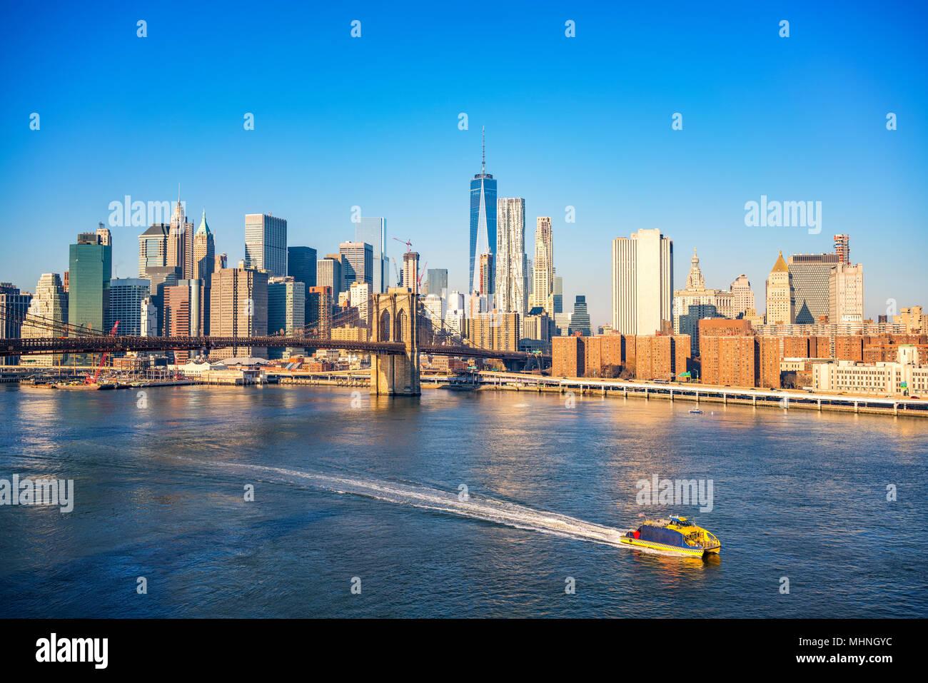 Brooklyn bridge and Manhattan at sunny day - Stock Image