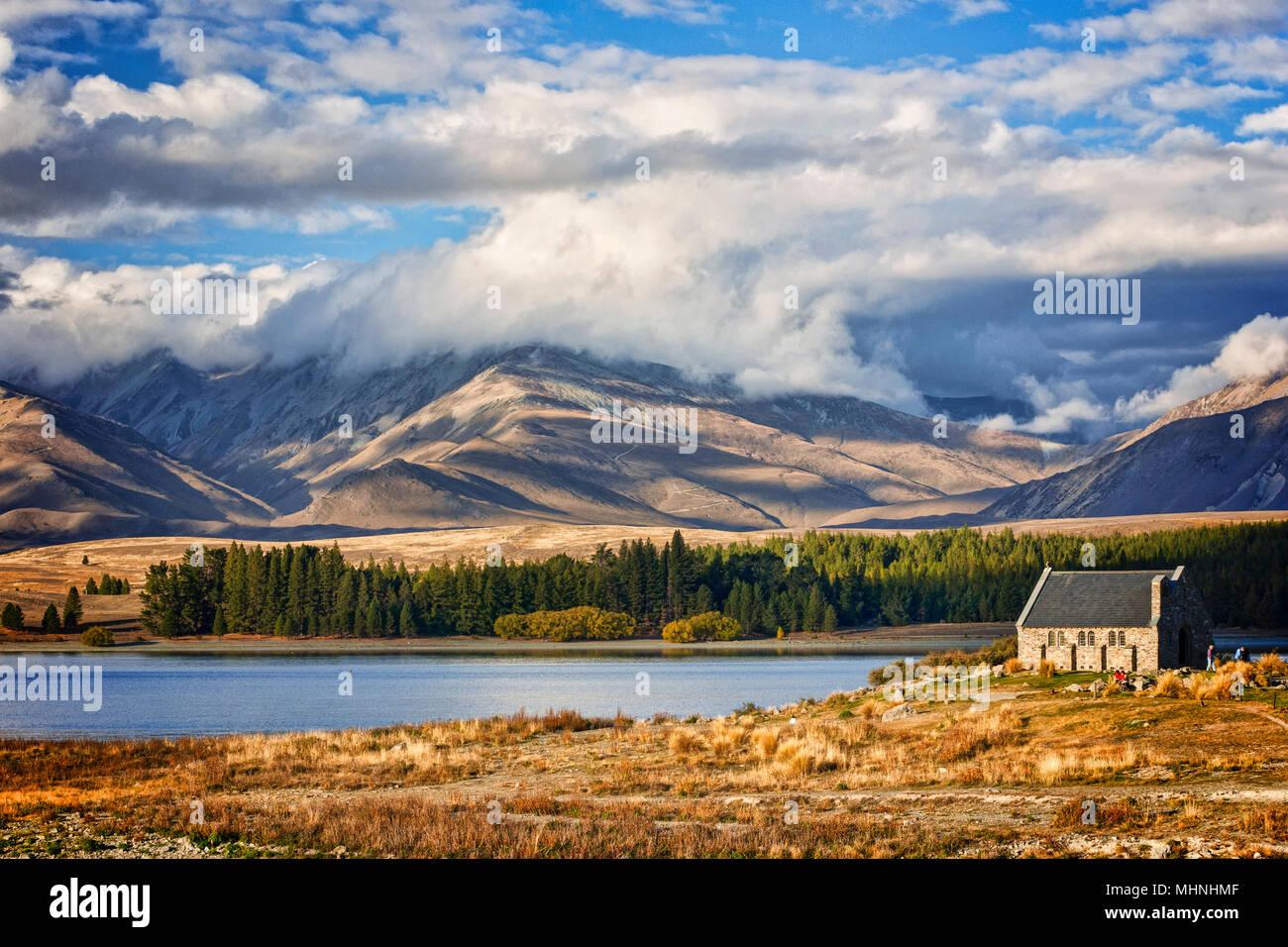 Lake Tekapo and the Church of the Good Shepherd, Canterbury, New Zealand, and the Two Thumb Range. Tekapo is a popular tourist destination. - Stock Image
