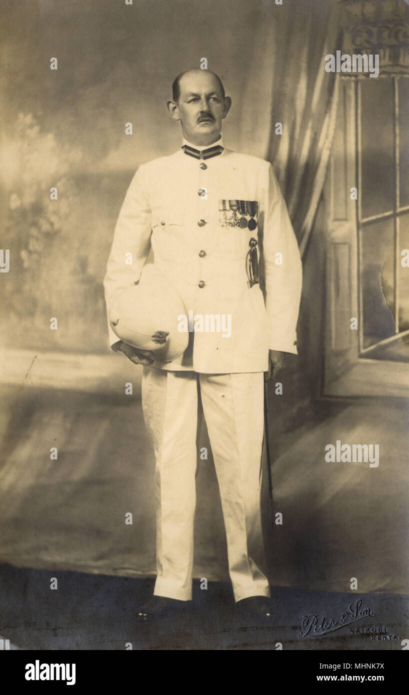 G. B. Rimmington - English Colonial District Commissioner, of Baringo County, Kenya, East Africa in his full uniform (plus military medals).     Date: 1934 - Stock Image