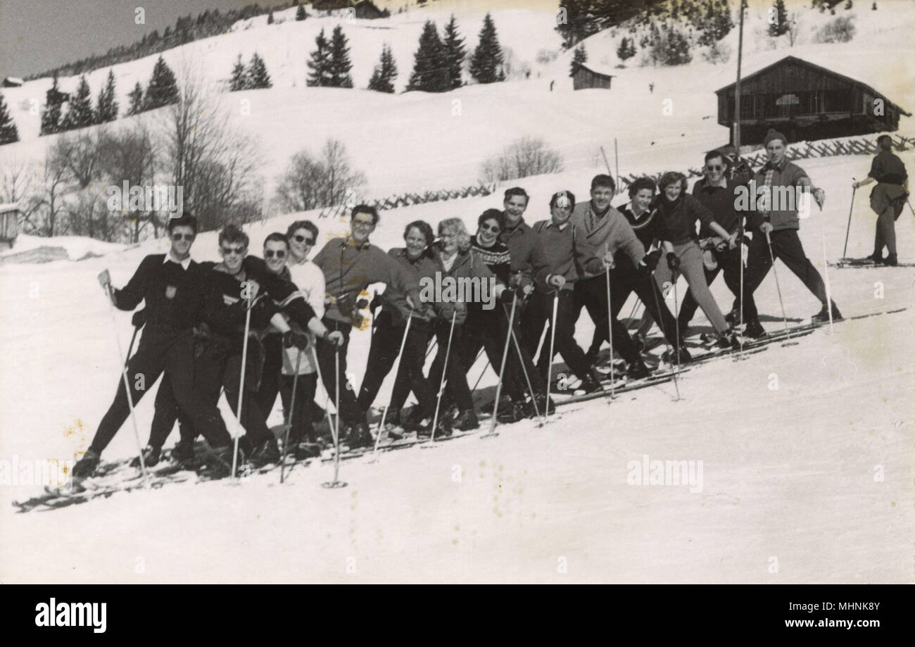 Fifteen Jolly Skiers having fun on the slopes - Austria.     Date: circa 1940s - Stock Image