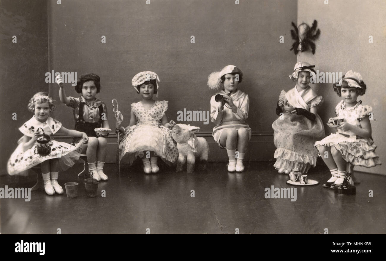 Six little girls dressed up in fancy dress as various nursery rhyme characters.  (At a guess), from left, Mary Mary, Quite Contrary, Little Jack Horner, Little Bo Peep, Little Boy Blue, Little Miss Muffett and Polly (Put the Kettle On).     Date: c.1930 - Stock Image