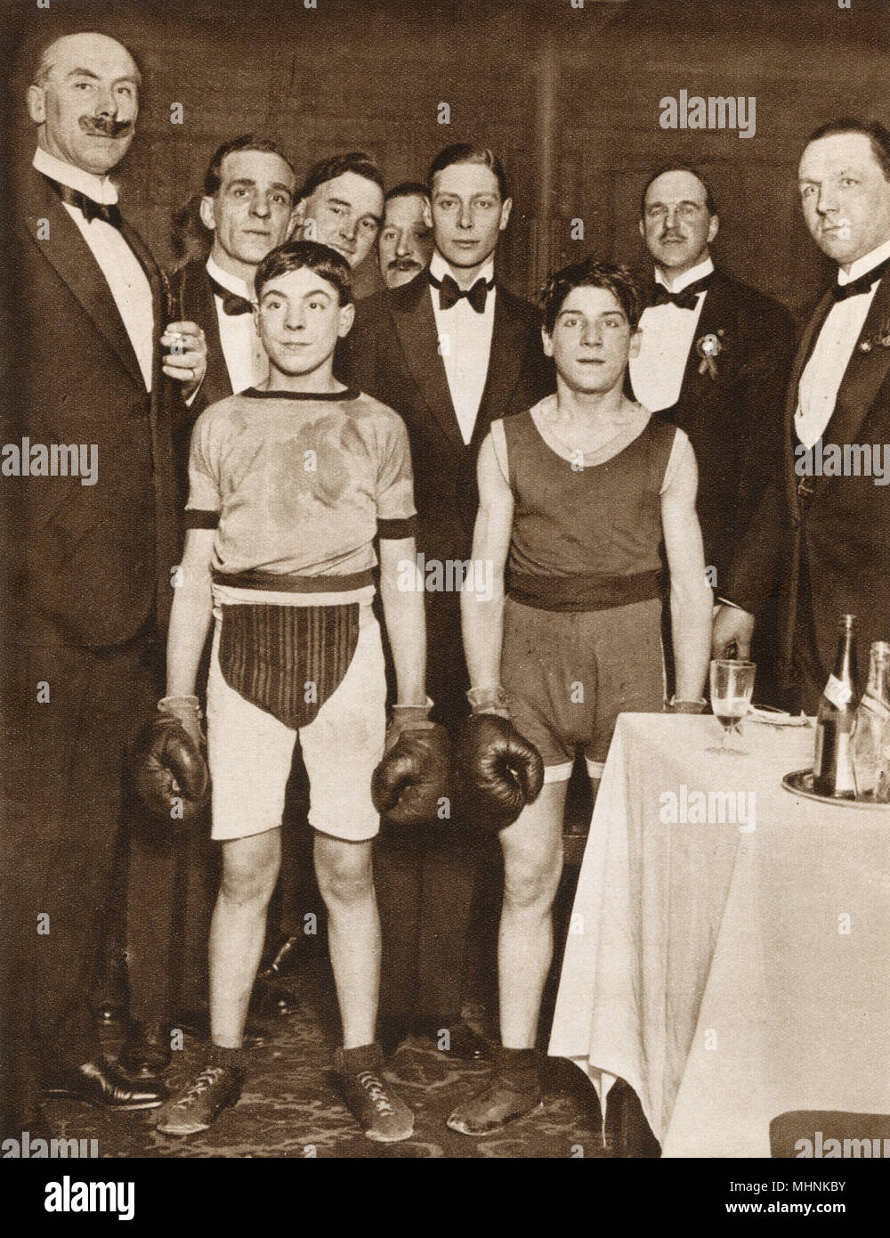 Albert, Duke of York (1895-1952) (later King George VI), pictured with two contestants in the Stable Lads Boxing Tournament, which took place at the National Sporting Club in aid of St. Dunstan's (Charity set up to aid blind and visually-impaired veterans). All the leading racing stables were represented.     Date: 1923 Stock Photo