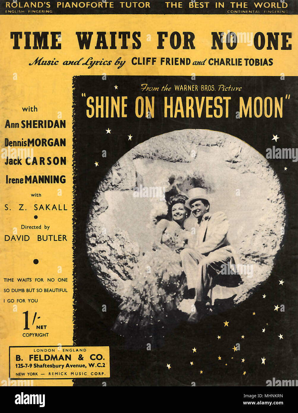 'Time waits for no one' - Music Sheet Cover, Time Waits for No One From the Warner Bros. Picture Shine on Harvest Moon, starring Ann Sheridan, Dennis Morgan, Jack Carson, and Irene Manning. Music and Lyrics by Cliff Friend and Charlie Tobias. An illustration with a photography of Ann Sheridan and Dennis Morgan sitting in front of a moon.     Date: circa 1944 - Stock Image