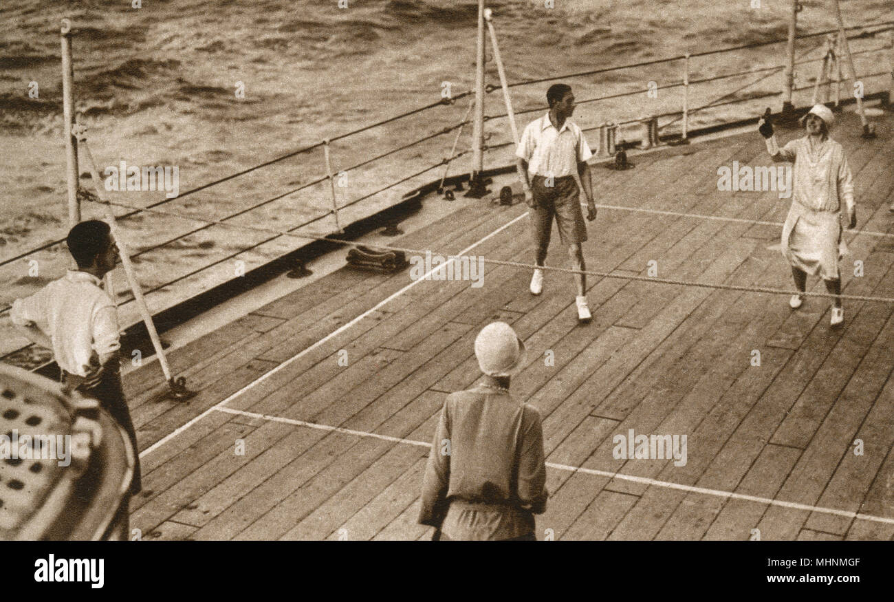 Duke and Duchess of York play Deck Tennis on HMS Renown on their return voyage from their Antipodean Tour. The Royal couple are pictured here playing against the Duke's equerry Major T. E. G. Nugent and the Hon. Mrs Little Gilmour, Lady-in-Waiting to the Duchess.     Date: 1927 - Stock Image