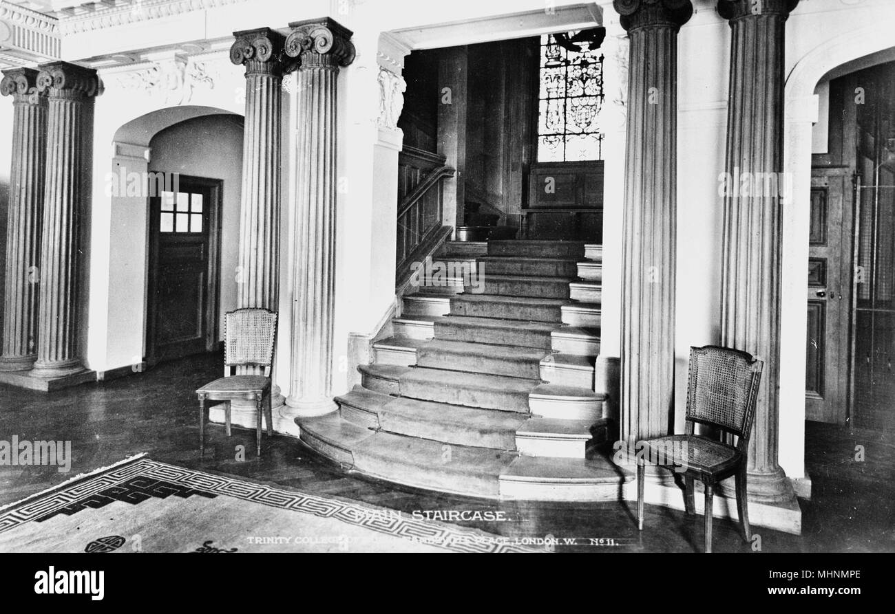 Trinity College of Music, Mandeville Place, London -- Entrance Hall, showing main staircase leading upwards.     Date: circa 1922 - Stock Image
