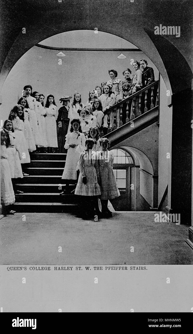 Girls and young women on the Pfeiffer Stairs at Queen's College, a girls' independent school in Harley Street, London.      Date: circa 1905 - Stock Image