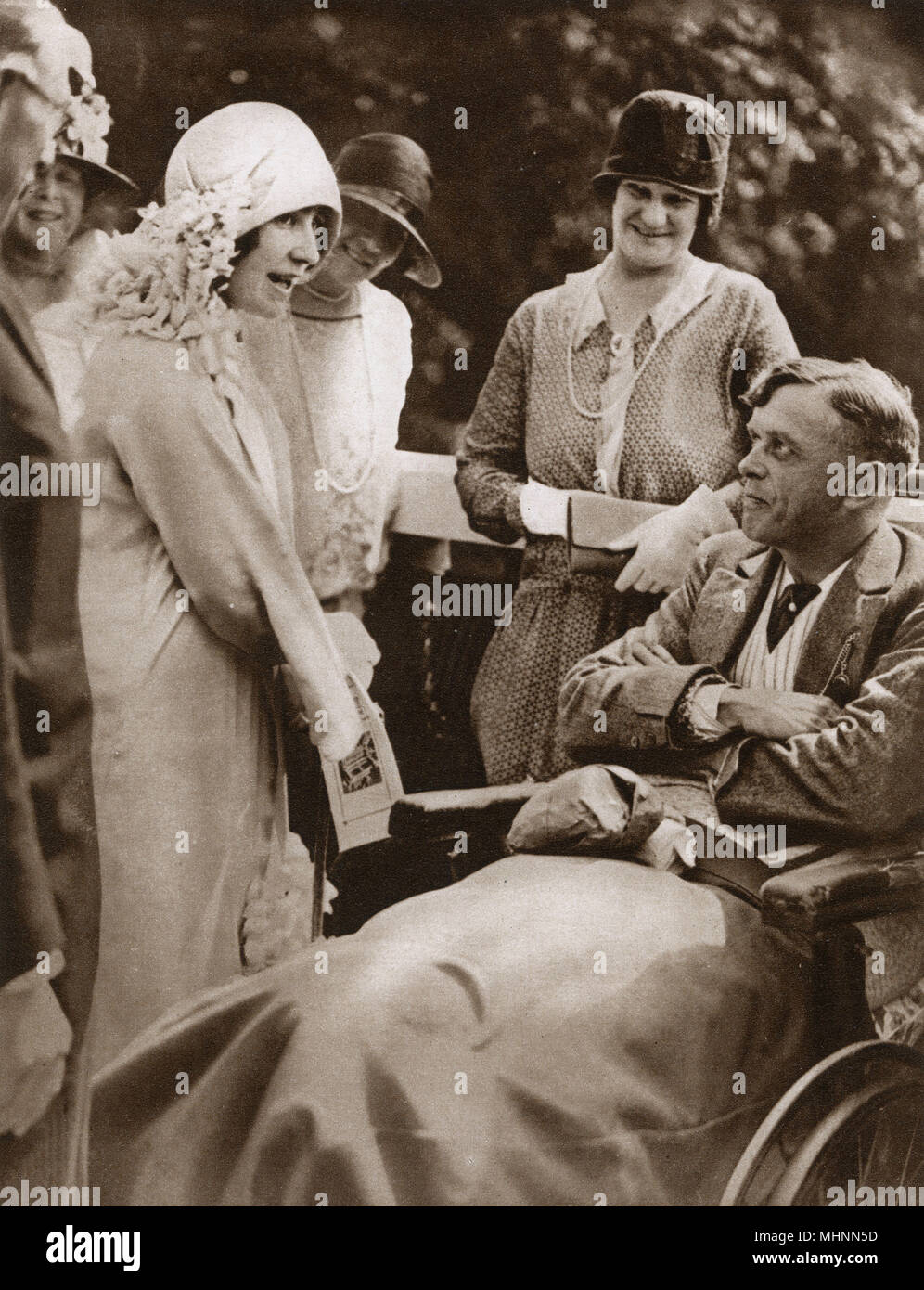 Elizabeth, Duchess York visiting The Star and Garter Home for wounded ex-servicemen at Richmond, Surrey and making conversation with a former British 'Tommy'.     Date: 1928 - Stock Image