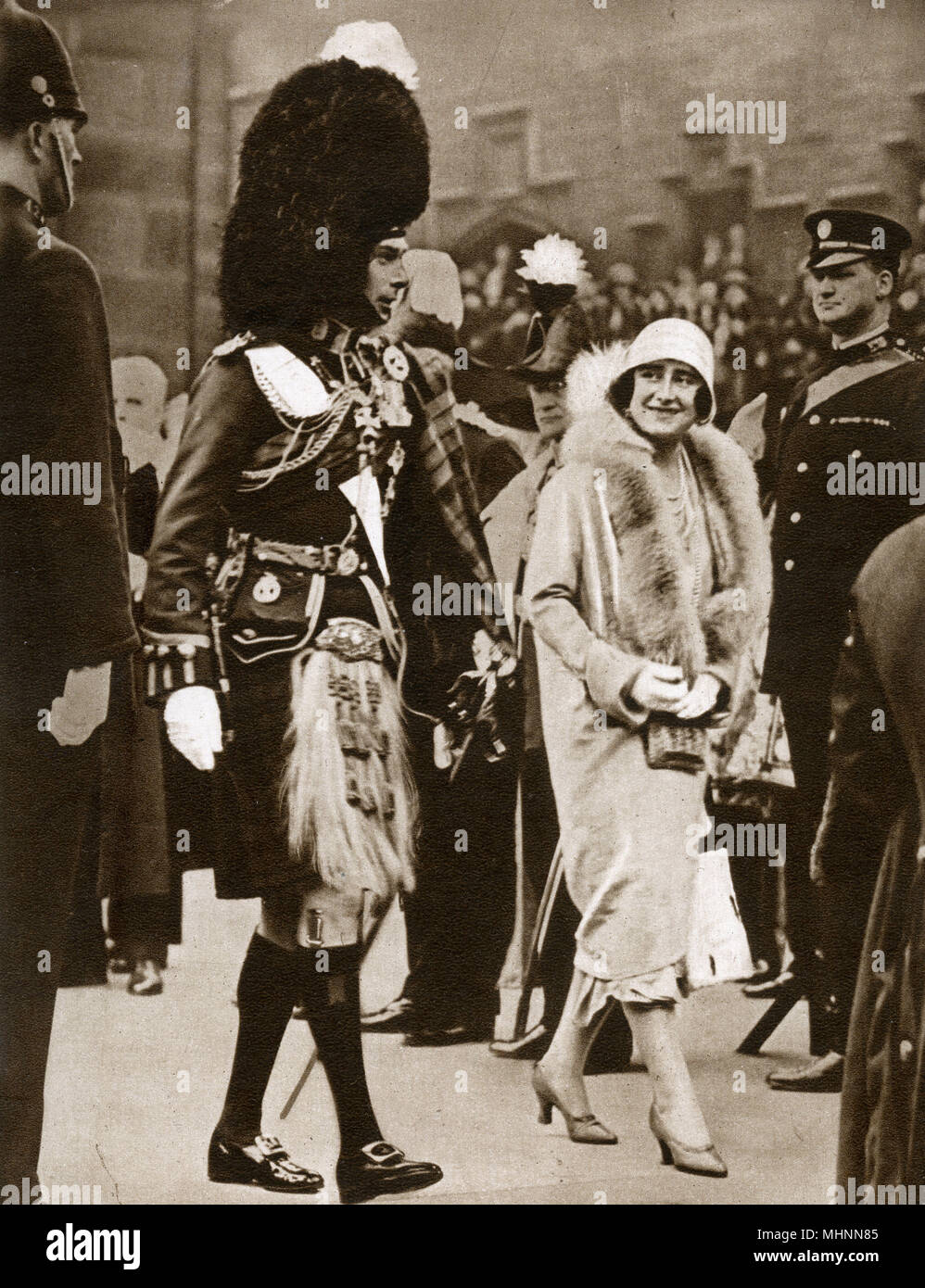Late in May 1929, the Duke and Duchess of York visited Edinburgh, Scotland. This photograph shows the Duke, in the full Dress of the Cameron Highlanders, walking with the Duchess to a service at St. Giles Cathedral.      Date: 1929 - Stock Image