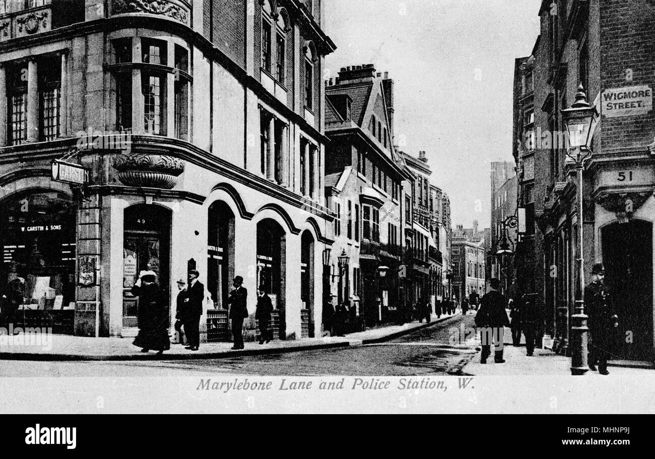 Marylebone Lane and police station, on the corner of Wigmore Street, London.      Date: circa 1910 - Stock Image