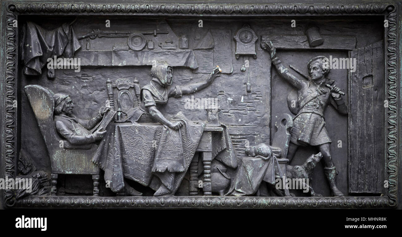 Glasgow in Scotland, plaque detail from Duke of Wellington statue has become an iconic landmark after a mysterious cone appeared - Stock Image