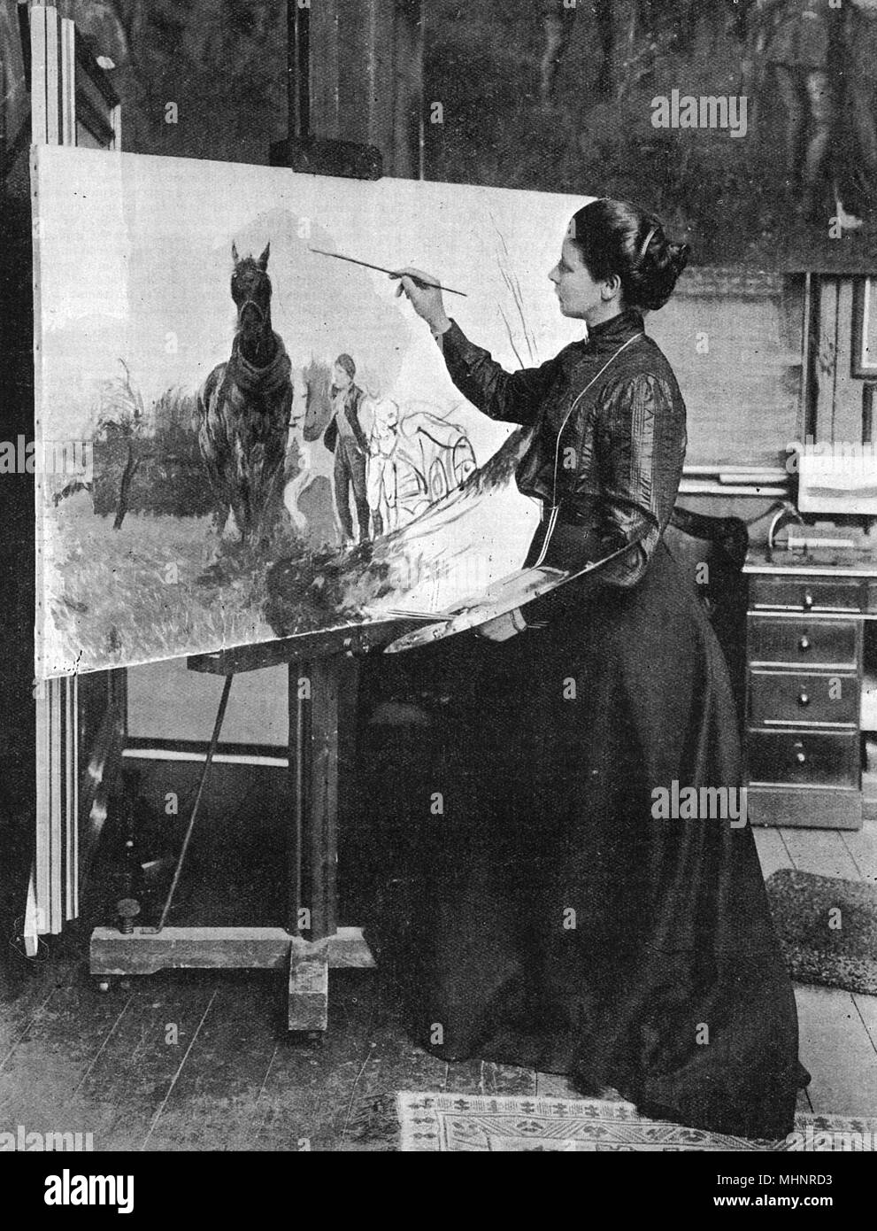 Lucy Kemp-Welch (1869 - 1958), artist and painter, mainly of equestrian subjects, pictured in her studio. Illustrated Black Beauty. as well as a number of World War I posters.      Date: 1906 - Stock Image