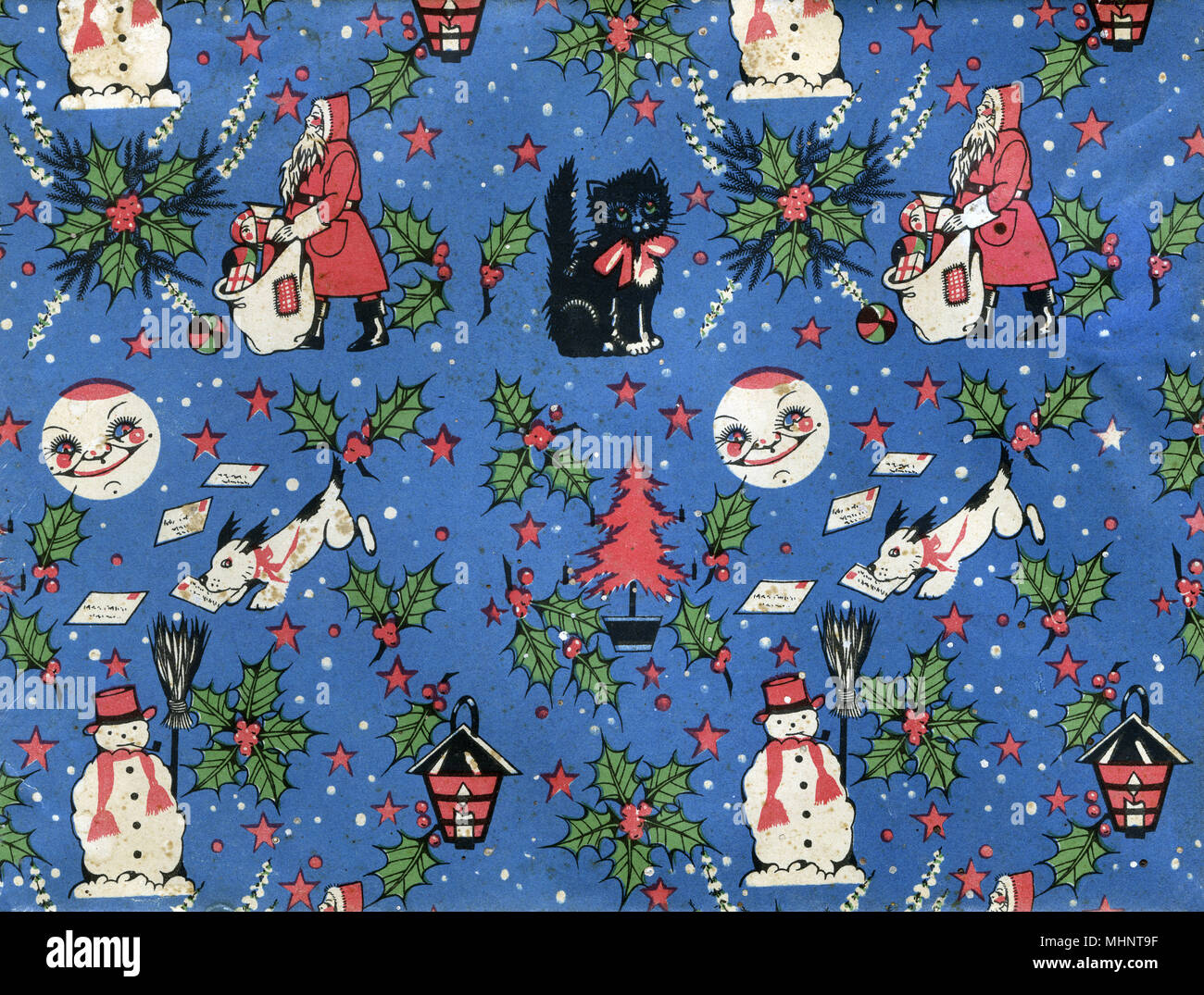 Vintage Retro Christmas Wrapping paper repeating pattern - featuring Father Christmas delivering presents, a small black kitten with a red ribbon, holly and red berries, a snowman, a dog 'helping' to deliver Christmas mail a lantern, a smiling moon, stars, snowflakes and red Christmas Trees.      Date: circa 1950s - Stock Image