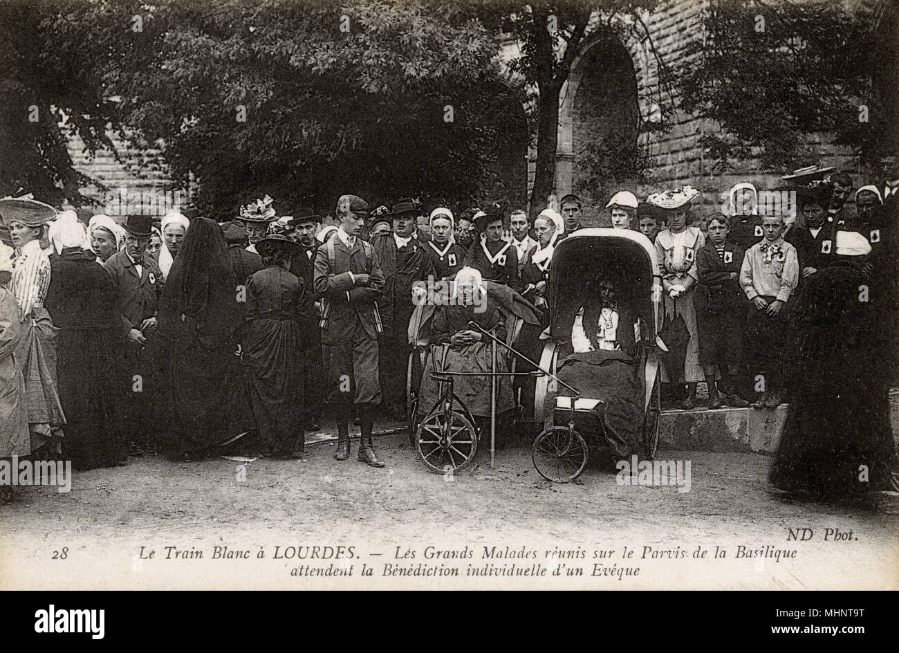 The 'White Train' at Lourdes. The Sick gather on the forecourt of the Basilica await the Individual Blessing of a Bishop.     Date: circa 1910 - Stock Image