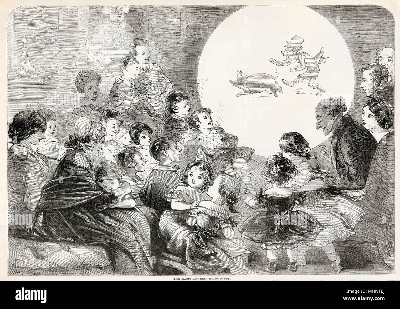 Evenings entertainment, with children amazed by the bright glass lantern slides been projected on the wall.     Date: 1858 - Stock Image