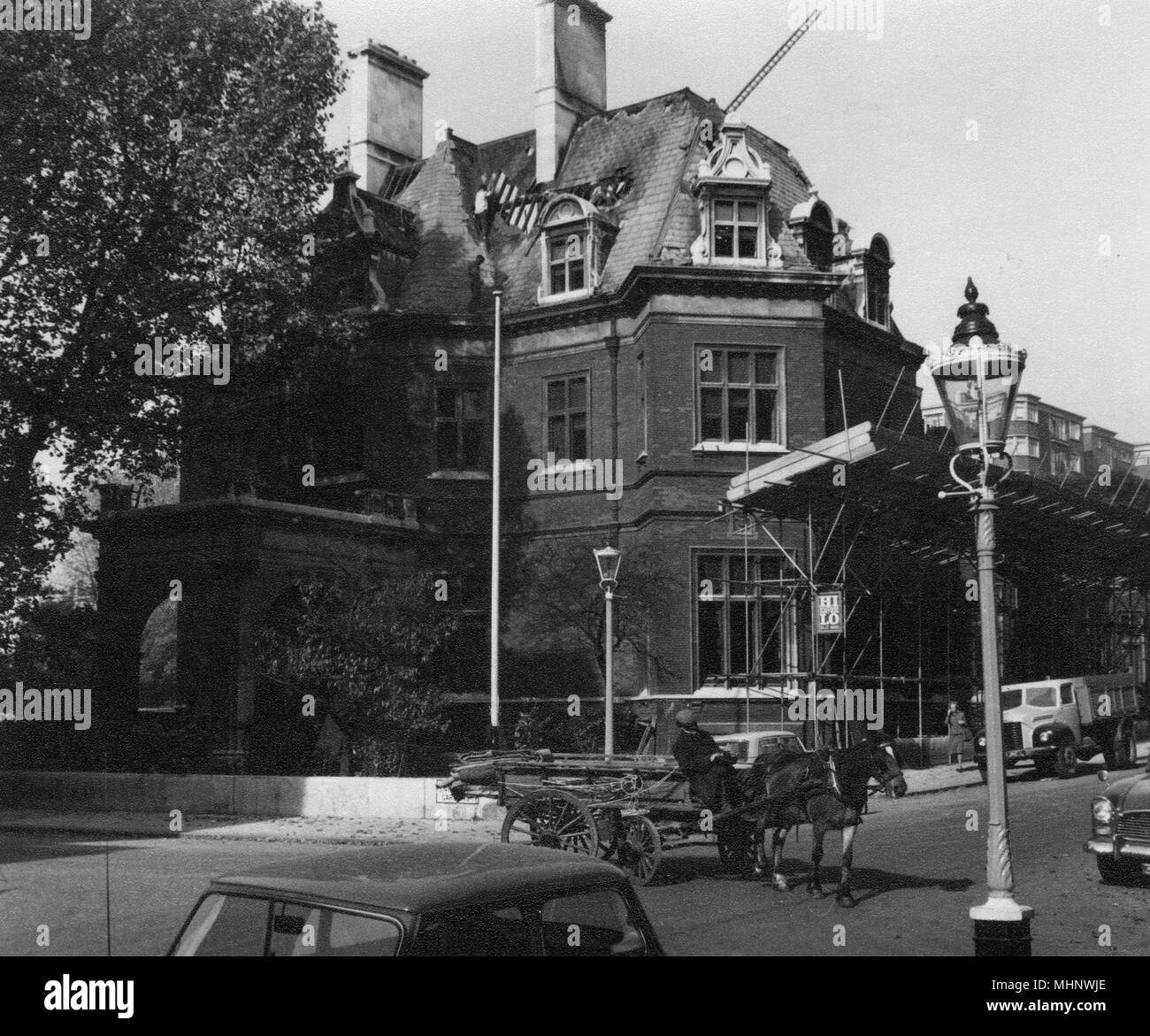 Moncorvo House, A large Victorian building at 67 Ennismore Gardens, Knightsbridge, London SW7 being demolished in September 1963. The building was designed by renowned Scottish Architect John Macvicar Anderson (1835-1915) and built 187880. Notable past residents of Moncorvo House were Albert George Sandeman, governor of the Bank of England, Henri d'Orleans, duke of Aumale, John Gretton, brewer and father of John Gretton, 1st Baron Gretton and Arthur Graham Glasgow, American engineer and industrialist.     Date: 1963 Stock Photo