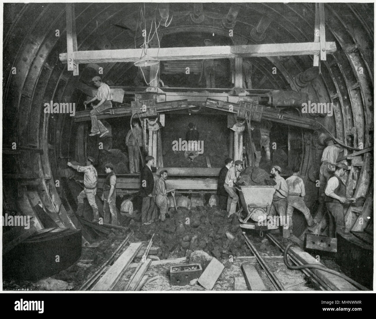 Under construction, workers in the 'shield', Great Northern and City Railway.     Date: circa 1900s - Stock Image