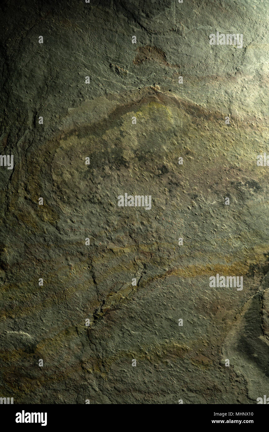 Stone texture background. Landscape like structures in green, rust and gold. Close up detail. Stock Photo