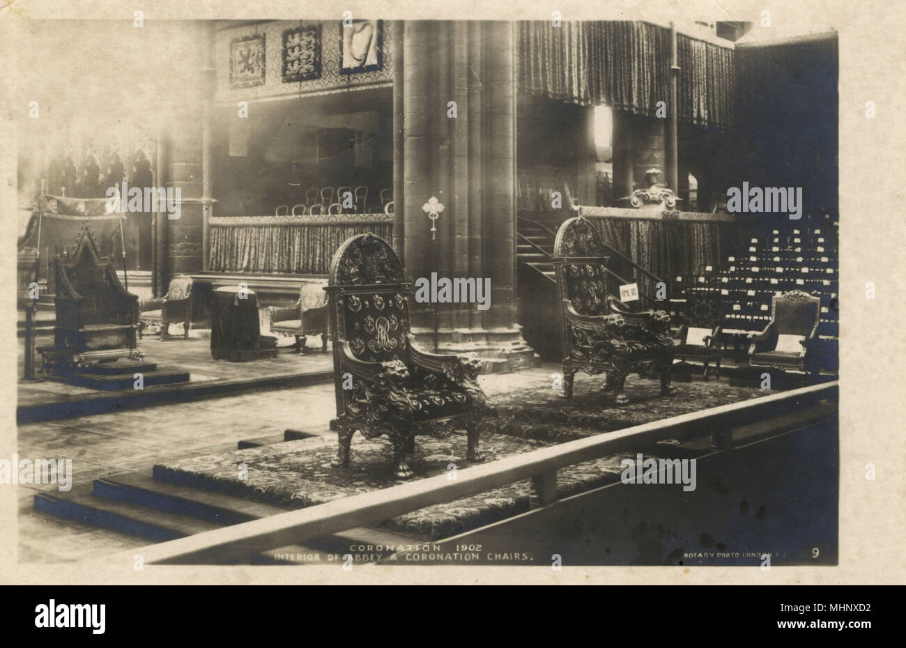 Coronation of King Edward VII and Queen Alexandra -- Westminster Abbey interior with Coronation Chairs.      Date: 1902 - Stock Image