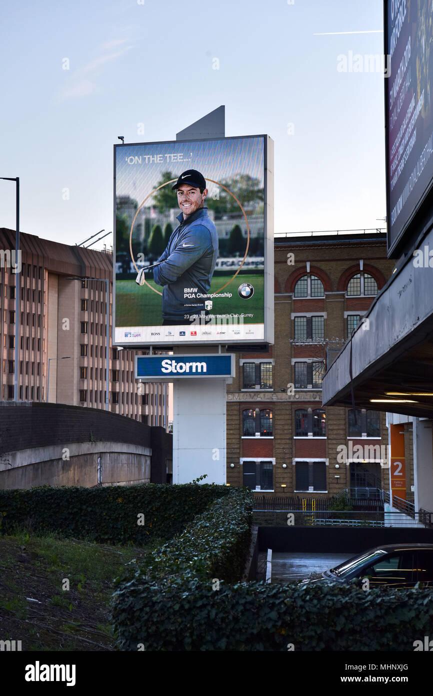 Storm Digital advertising hoardings promoting BMW PGA Championship on the Talgarth Road, Fulham  in West London, UK. - Stock Image