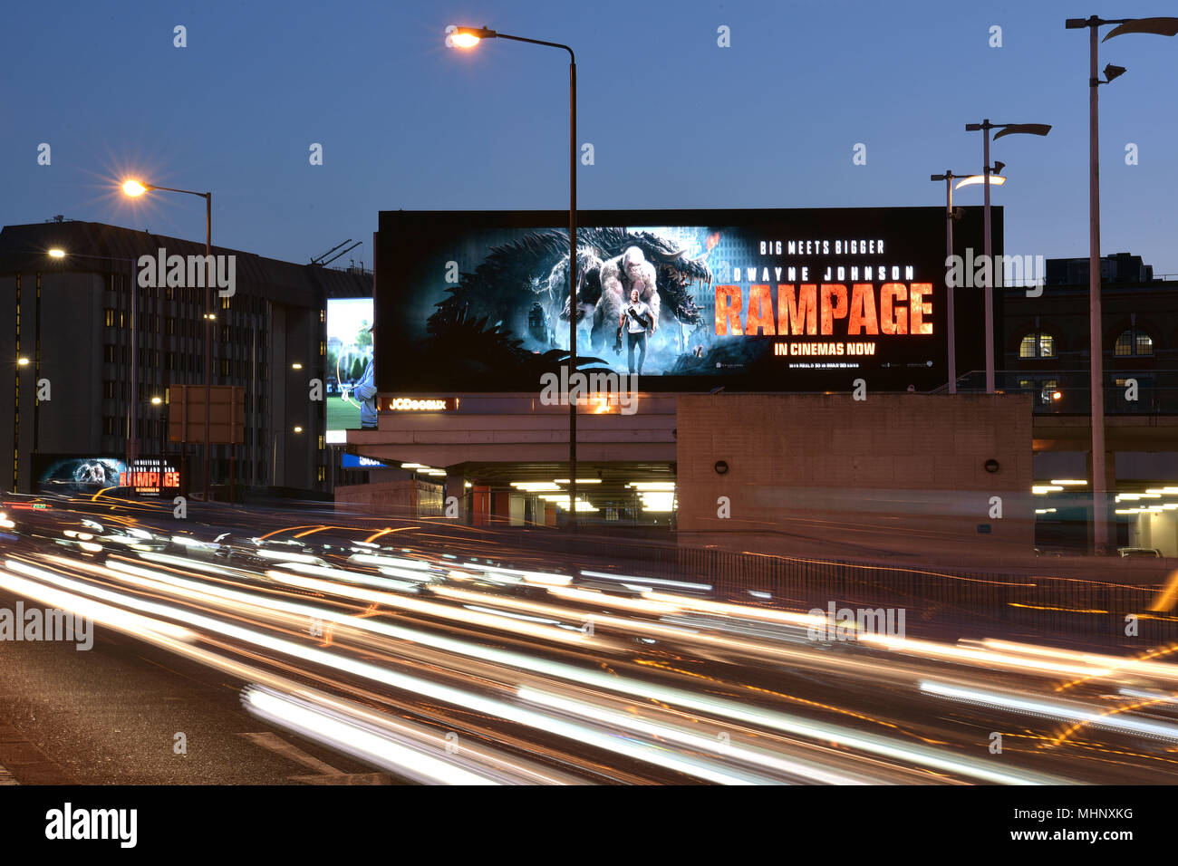 Digital advertising hoardings promoting the film Rampage on the Talgarth Road, Fulham  in West London, UK. - Stock Image