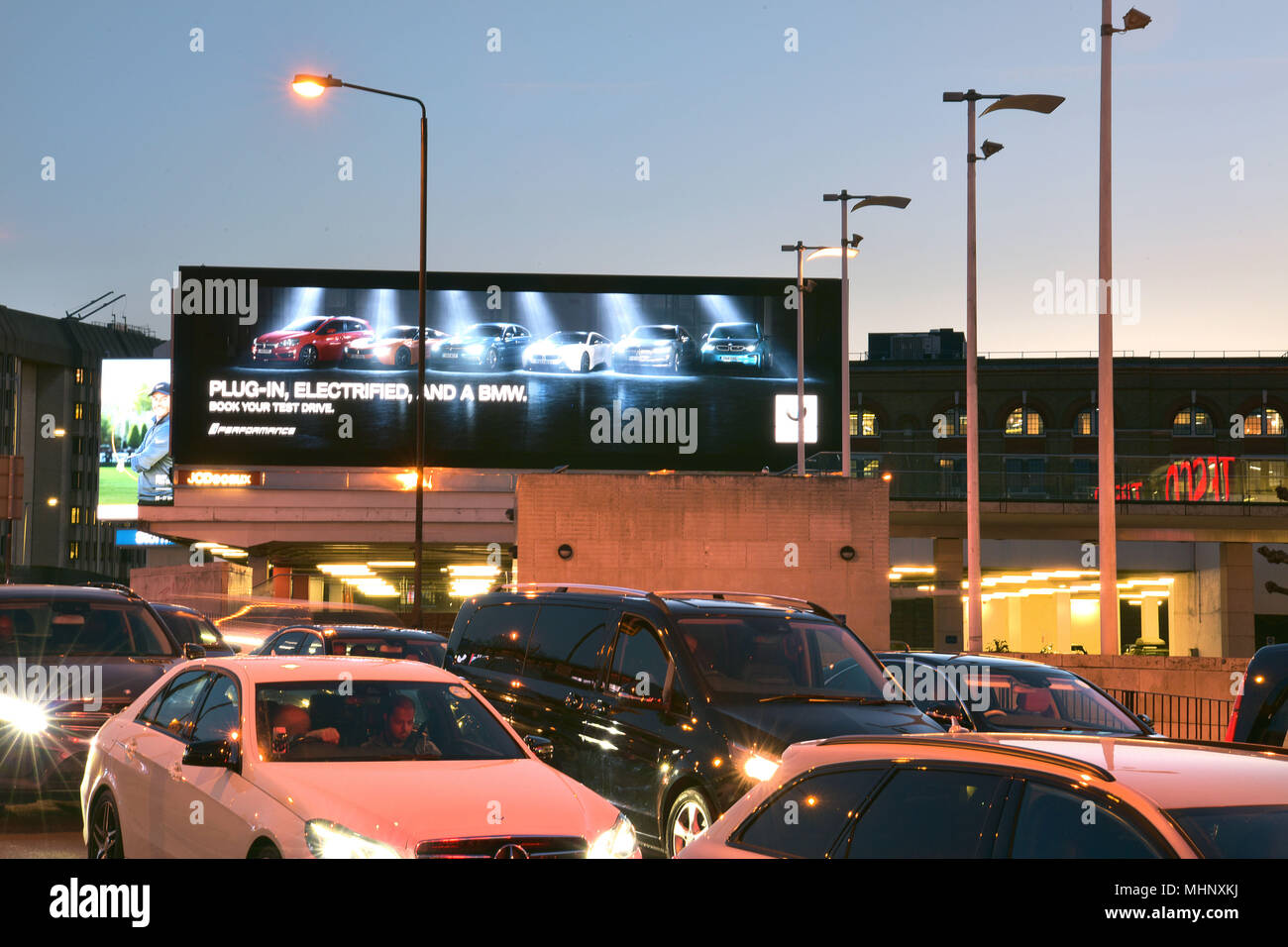 Digital advertising hoardings promoting the electric BMW car on the Talgarth Road, Fulham  in West London, UK. - Stock Image