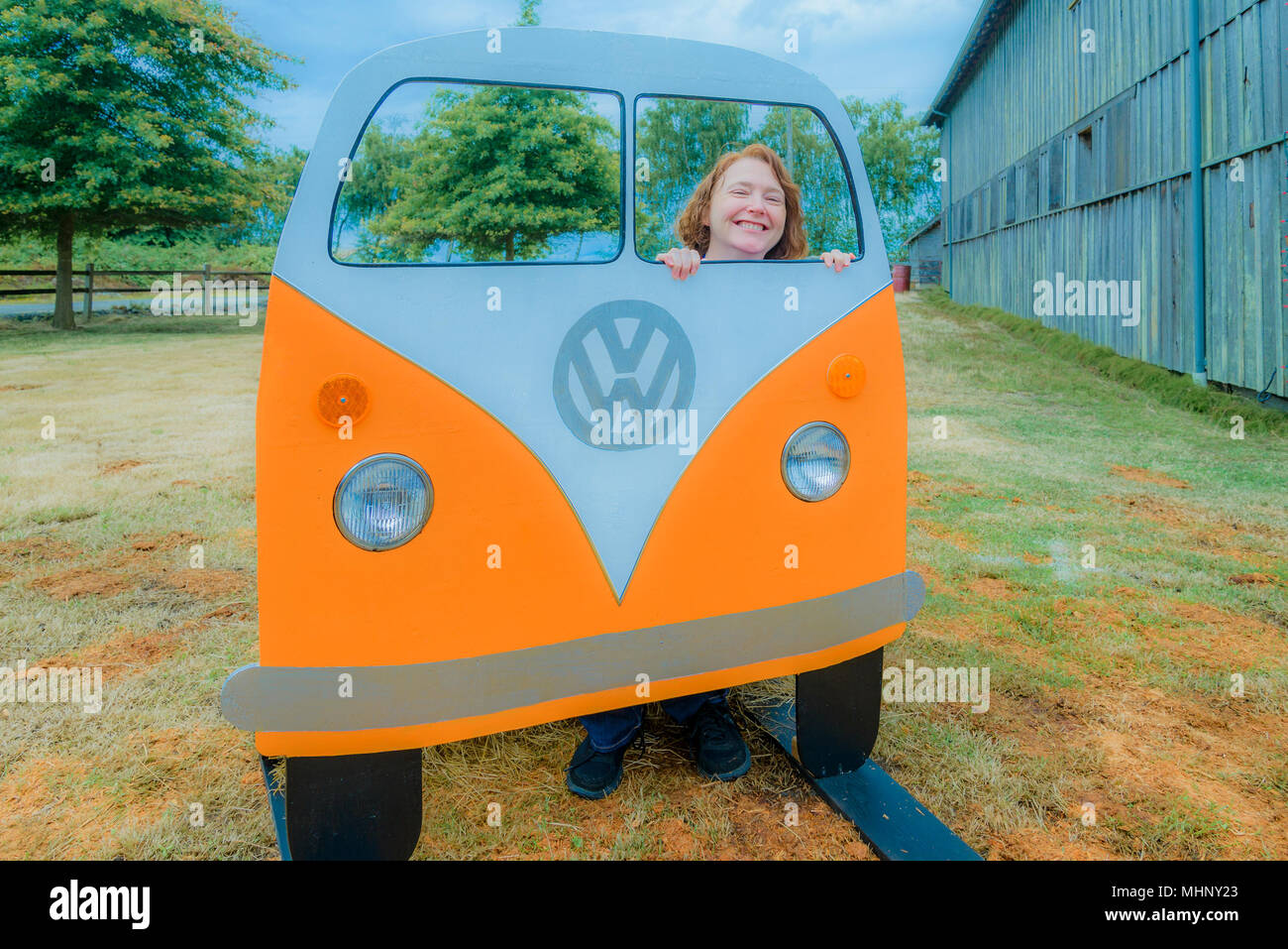 woman enjoys photo op, VW Bus mock up, Deja Vu Vintage Market, Wellbrook Winery, Delta, British Columbia, Canada - Stock Image