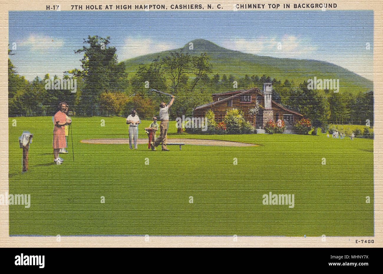 Golfing at the 7th hole, High Hampton, Cashiers, North Carolina, USA, with the Chimney Top Mountain in the distance.      Date: 1940s - Stock Image