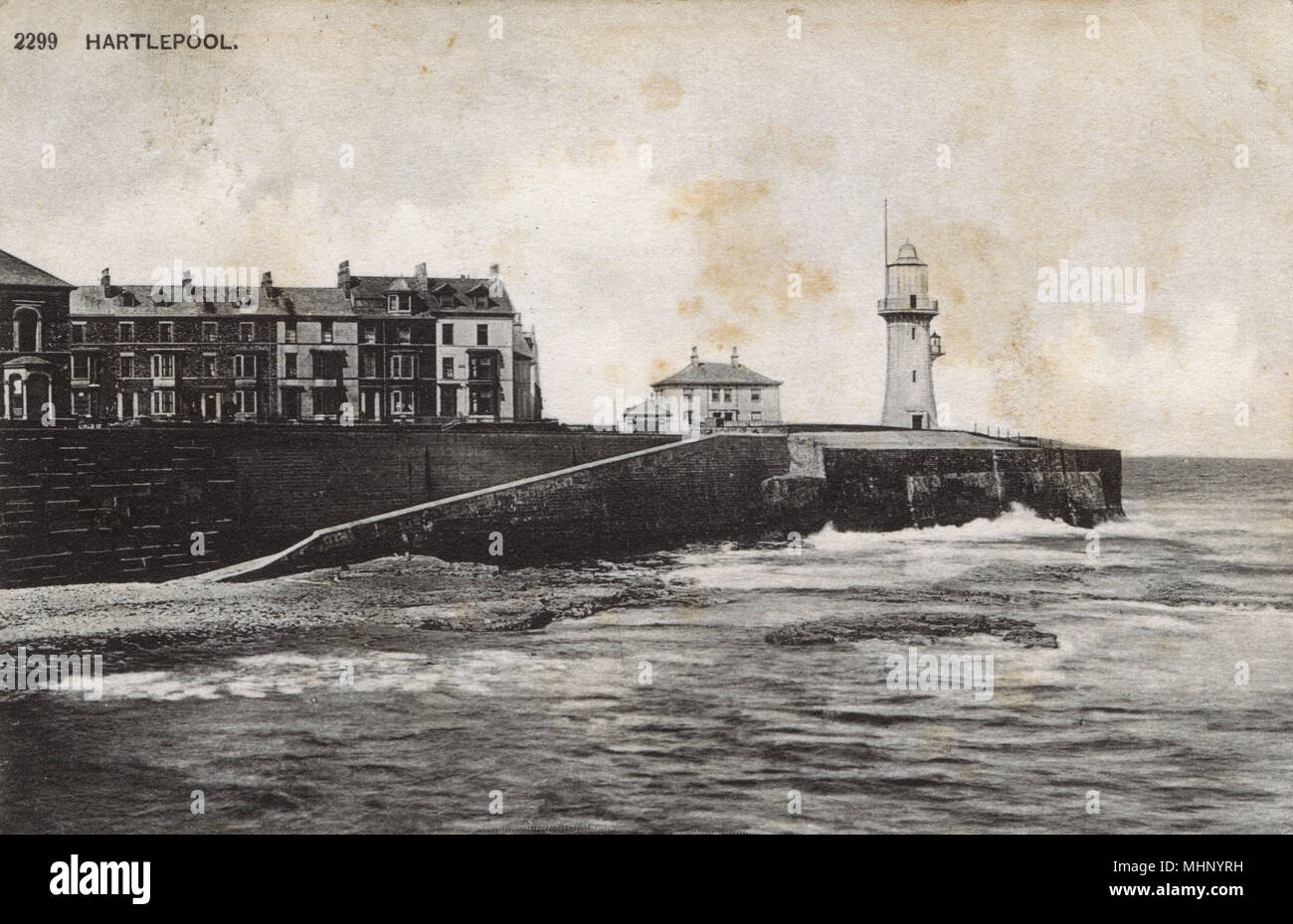 View of Hartlepool, terraced buildings and lighthouse, County Durham.      Date: circa 1900s - Stock Image