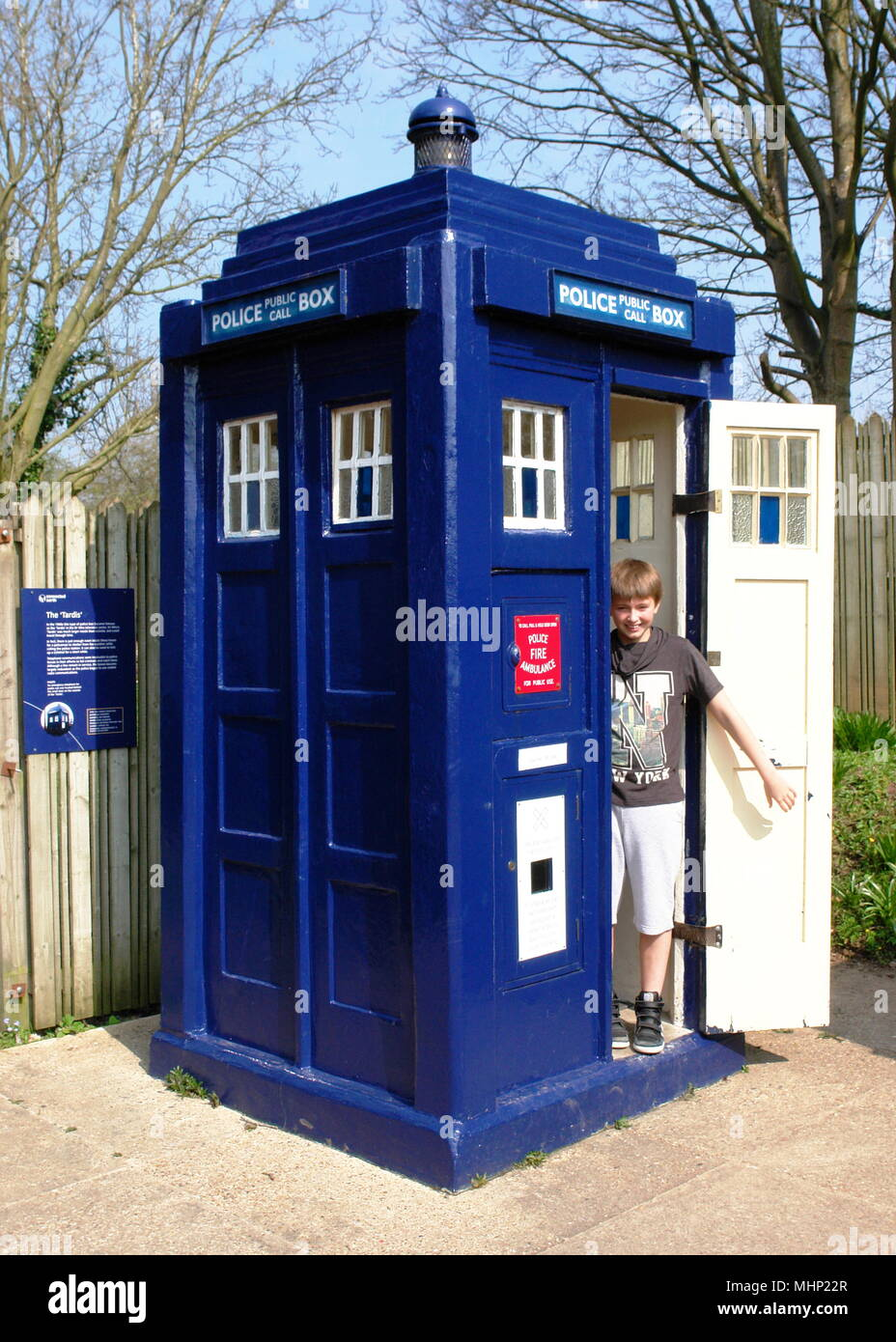 A smiling boy stands in the open doorway of a Tardis police box (as seen in the popular TV series, Doctor Who) at the Avoncroft Museum of Buildings, near Bromsgrove, Worcestershire.     Date: 2010s - Stock Image