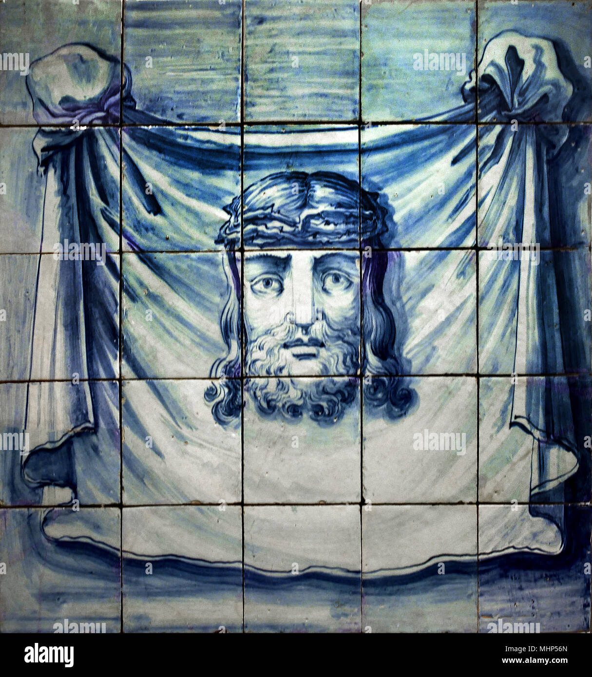 The Sudarium of Saint Veronica and the 'true image' of Jesus Christ wearing a crown of thrones 18th Century. Portuguese Azulejo - Blue wall  Tiles, Portugal - Stock Image