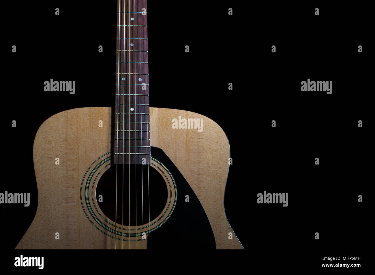 New Acoustic Guitar On Black Background Stock Photo 183041057 Alamy