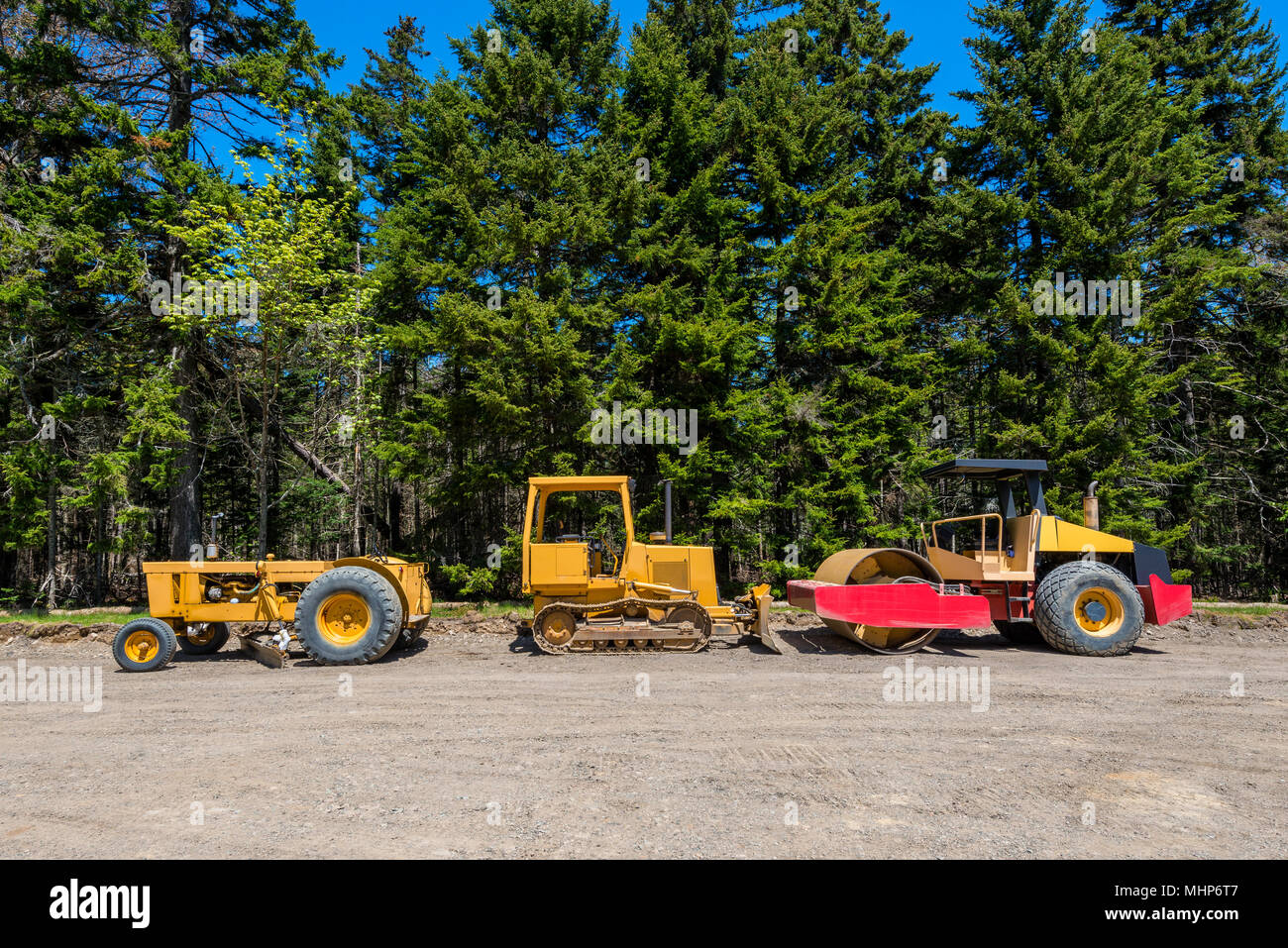 Earth Movers at Road Contruction Site in Forest - Stock Image