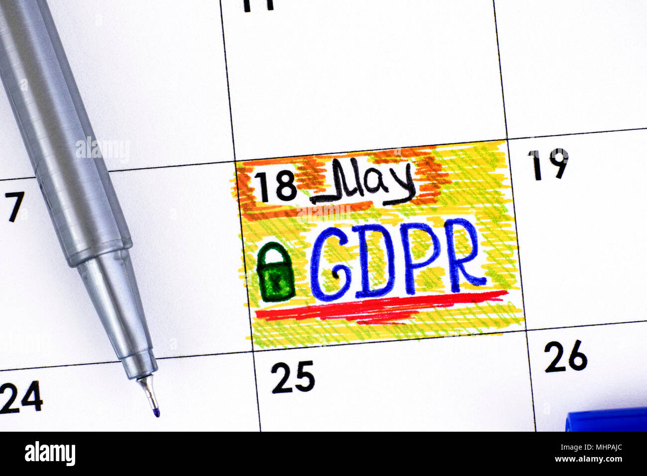 Reminder GDPR in calendar with blue pen. Close-up. - Stock Image
