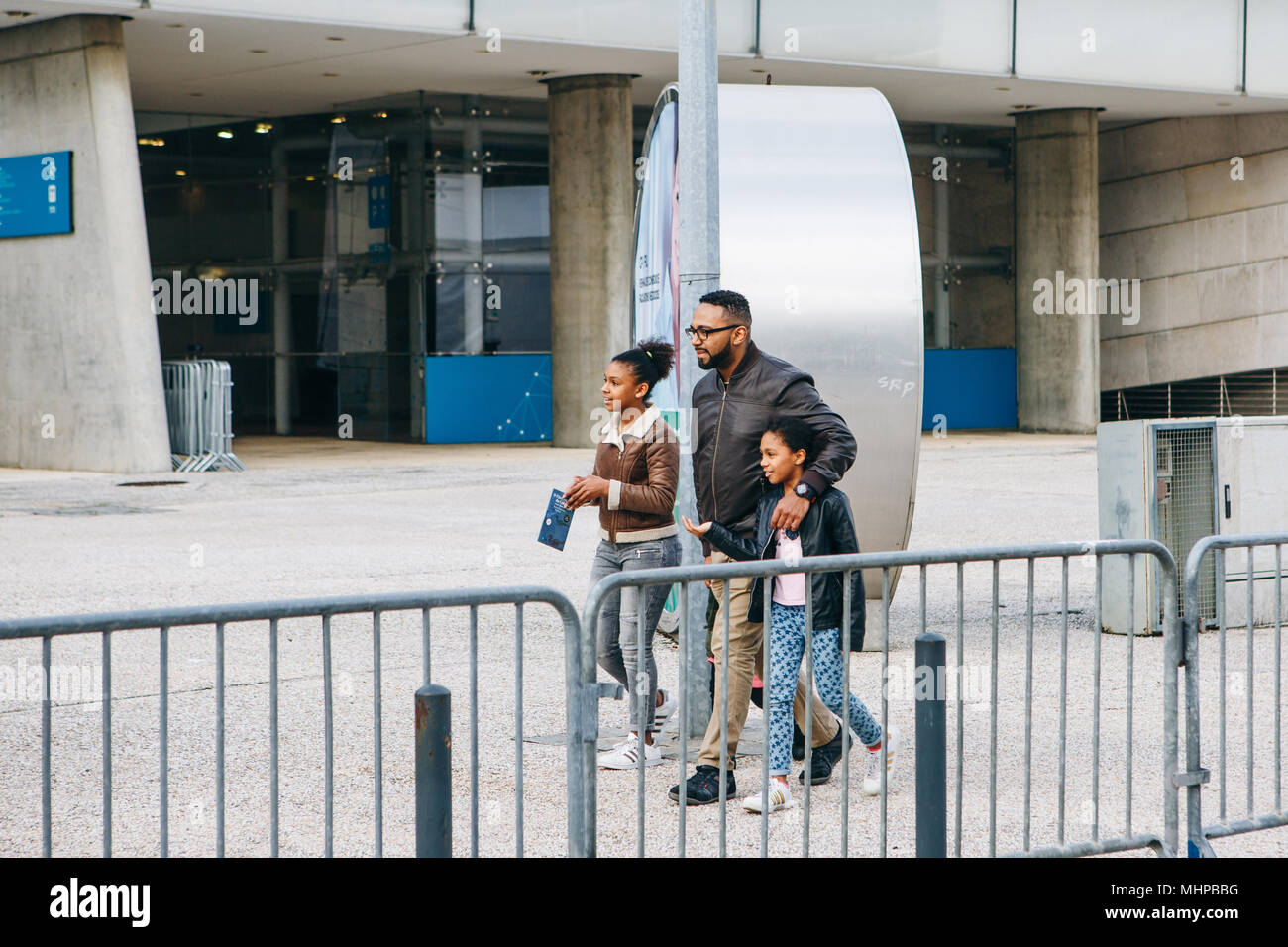 Portugal, Lisbon 29 april 2018: family or tourists or group of people walk down by street Stock Photo
