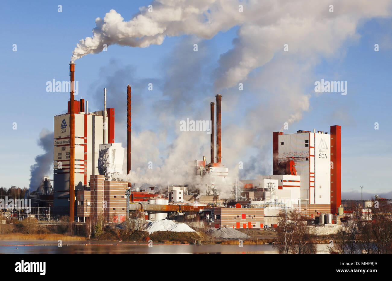 Timra, Sverige - November 8, 2013: Ostrand pulp mill, a factory in the forest products group SCA. - Stock Image