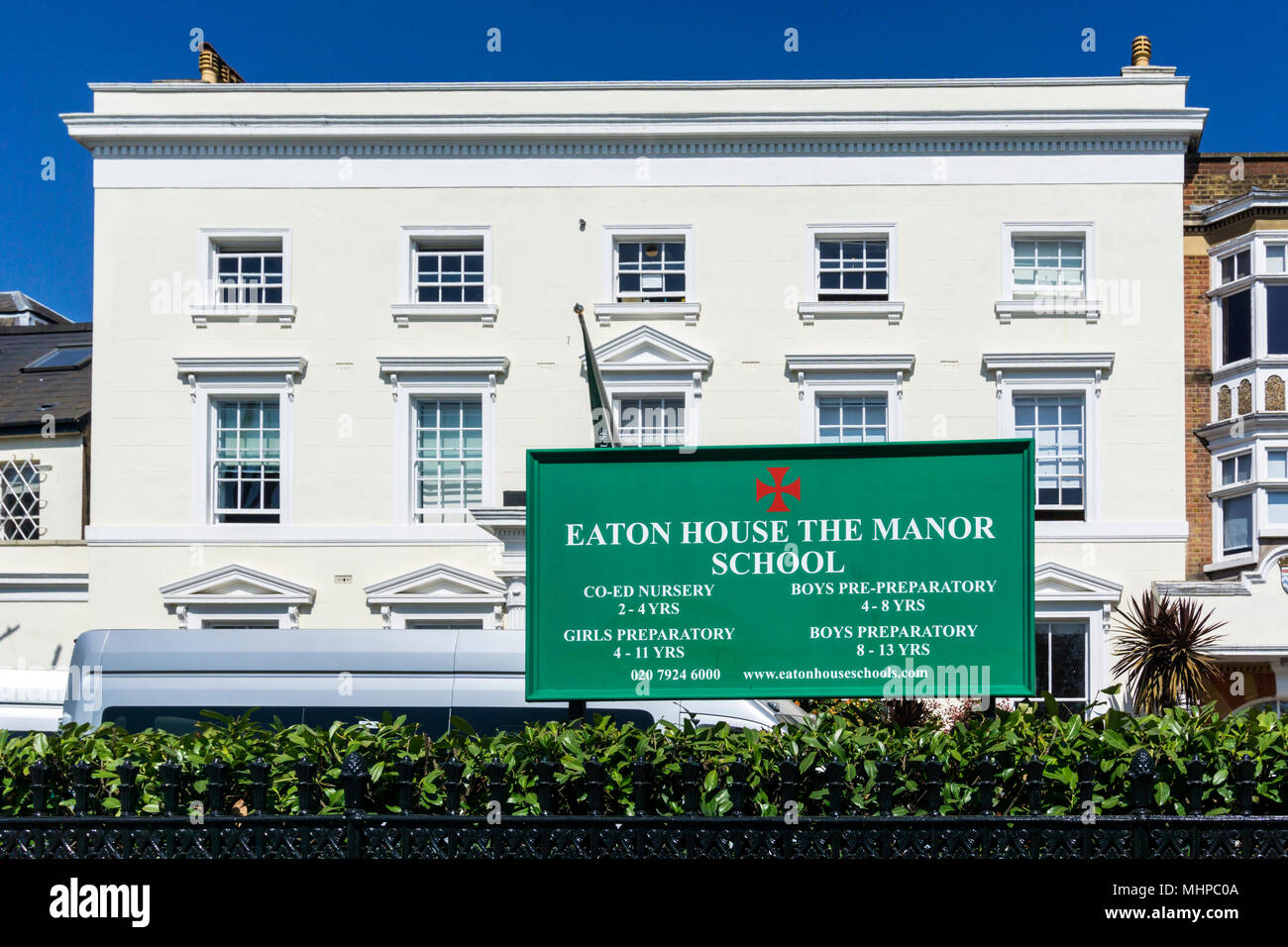 Sign for The Manor, one of the Eaton House group of schools.  On Clapham Common North Side. - Stock Image