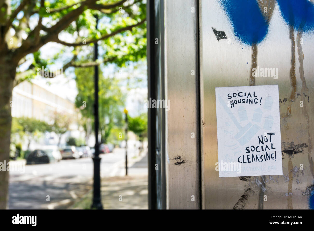 Social Housing! Not Social Cleansing! slogan on a sticker in Lambeth, South London. - Stock Image